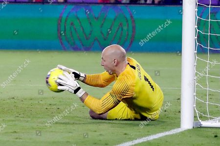 U.S. goalkeeper Brad Guzan blocks a shot during the first half of the team's CONCACAF Nations League soccer match against Canada, in Orlando, Fla