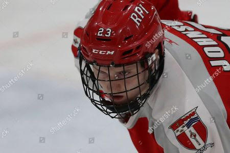 Rensselaer defenseman Jake Johnson (23) gets set before a face-off during an NCAA hockey game against Princeton, in Princeton, N.J. The game ended in a 2-2 draw