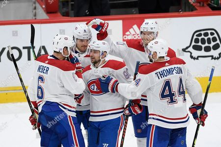 Montreal Canadiens left wing Tomas Tatar (90) celebrates his empty-net goal with defenseman Shea Weber (6), center Nate Thompson (44), defenseman Ben Chiarot (8) and right wing Joel Armia (40) during the third period of an NHL hockey game against the Washington Capitals, in Washington