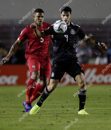 Mexico's Raul Jimenez, front, is challenged by Panama's Roman Torres during a CONCACAF Nations League soccer match at the Rommel Fernandez stadium in Panama City