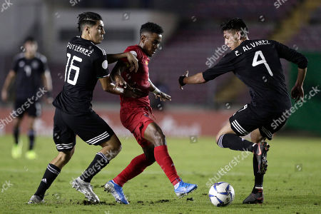 Stock Photo of Panama's Edgar Barcenas, center, fights for the ball against Mexico's Erick Gutierrez, left, and Edson Alvarez during a CONCACAF Nations League soccer match at the Rommel Fernandez stadium in Panama City
