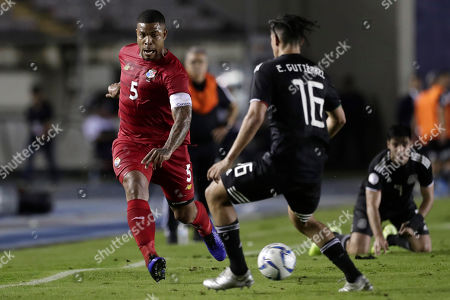 Panama's Roman Torres, left, and Mexico's Erick Gutierrez, center, compete for the ball during a CONCACAF Nations League soccer match at the Rommel Fernandez stadium in Panama City