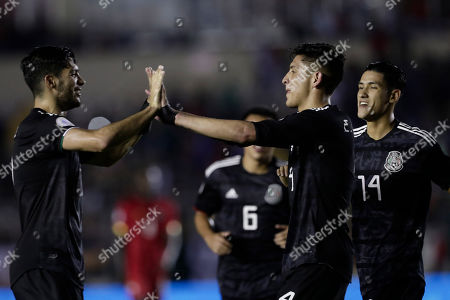 Mexico's Edson Alvarez, second from right, celebrates scoring his side's 2nd goal against Panama with teammates Raul Jimenez, left, and Carlos Antuna during a CONCACAF Nations League soccer match at the Rommel Fernandez stadium in Panama City