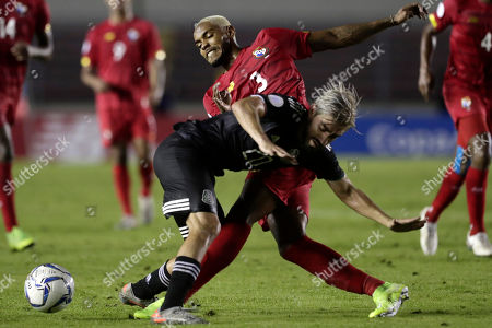 Stock Picture of Panama's Azmahar Ariano, back, and Mexico's Rodolfo Pizarro fight for the ball during a CONCACAF Nations League soccer match at the Rommel Fernandez stadium in Panama City