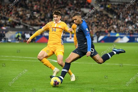 Kylian Mbappe of France and Artur Cracium of Moldova