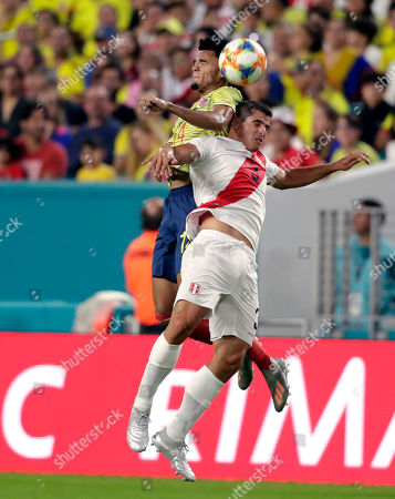 Luis Díaz, Aldo Corzo. Colombia forward Luis Díaz, left, and Peru defender Aldo Corzo, right, go for the ball during the first half of an international friendly soccer match, in Miami Gardens, Fla