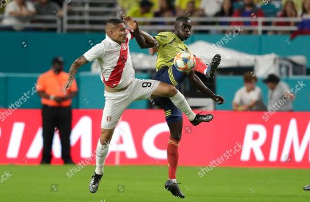 Stock Picture of Paolo Guerrero, Davinson Sánchez. Peru forward Paolo Guerrero (9) and Colombia defender Davinson Sánchez, right, go for the ball during the first half of an international friendly soccer match, in Miami Gardens, Fla