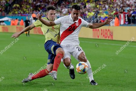 Santiago Arias, Cristian Benavente. Colombia defender Santiago Arias (4) and Peru midfielder Cristian Benavente (24) go for the ball during the second half of an international friendly soccer match, in Miami Gardens, Fla
