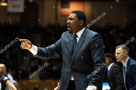 Stock Image of Duke Associate Head Coach Nate James shouts towards the court during an NCAA college basketball game against Georgia State in Durham, N.C