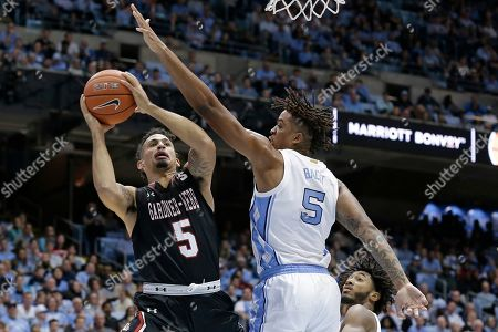 Gardner Webb guard Jose Perez, left, drives to the basket while North Carolina forward Armando Bacot, right, defends during the second half of an NCAA college basketball game in Chapel Hill, N.C