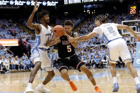 North Carolina guards Leaky Black (1) and Cole Anthony (2) pressure Gardner Webb guard Jose Perez (5) during the second half of an NCAA college basketball game in Chapel Hill, N.C