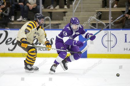 Zac Herrmann (13) of Niagara and Matt Long (25) of Canisius during an NCAA hockey game on in Buffalo, N.Y
