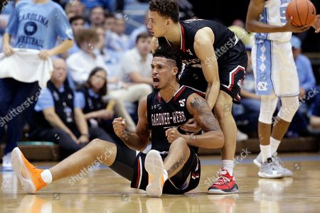 Gardner Webb guard Lance Terry reaches to pick up guard Jose Perez (5) during the second half of an NCAA college basketball game against North Carolina in Chapel Hill, N.C