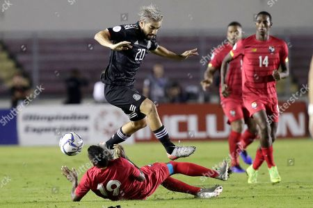 Stock Photo of Panama's midfielder Alberto Quintero (bottom) in action against Mexico's midfielder Rodolfo Pizarro (top) during a Concacaf Nations League soccer match at the Rommel Fernandez Stadium, in Panama City, Panama, 15 November 2019.