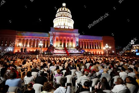Guests attend a show putside the National Capitol Building during the celebration of the 500th anniversary of Havana's foundation, in Havana, Cuba, 16 November 2019. Cuba celebrated 500 years since the founding of the city of San Cristobal de La Habana by Spaniard Diego Velazquez de Cuellar in 1519.