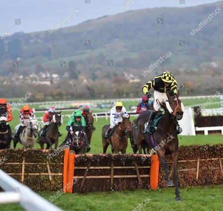 Stock Picture of Golan Fortune (Sam Lee) takes the last before going on to win The Spinal Injuries Association Big Bucks Handicap Hurdle Race.