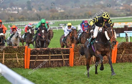 Golan Fortune (Sam Lee) takes the last before going on to win The Spinal Injuries Association Big Bucks Handicap Hurdle Race.