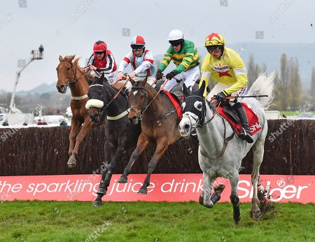 (2nd R) Barry Geraghty, jockey and Defi Du Seuil take the last before going on to win The Shloer Steeple Chase from (R) Politologue (Harry Cobden).