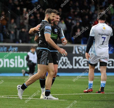 Ali Price and Tommy Seymour - Glasgow Warriors players celebrate an 11-7 victory against Sale Sharks.