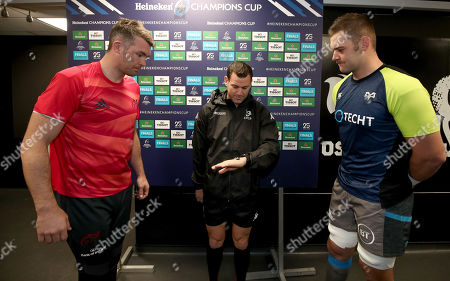 Ospreys vs Munster. Munster captain Peter O'Mahony, referee Karl Dickson and Ospreys captain Dan Lydiat during the coin toss