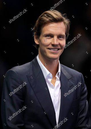Stock Photo of Tomas Berdych of the Czech Republic smiles as he stands on court during a ceremony to honour former tennis players at the ATP World Tour Finals at the O2 Arena in London