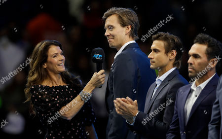 Tomas Berdych of the Czech Republic, second left, is interviewed by television presenter Annabel Croft as he stands on court during a ceremony to honour former tennis players at the ATP World Tour Finals at the O2 Arena in London