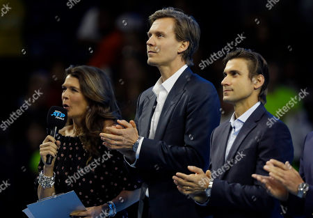 Tomas Berdych of the Czech Republic, centre, stands by television presenter Annabel Croft, left, and David Ferrer of Spain during a ceremony to honour former tennis players at the ATP World Tour Finals at the O2 Arena in London