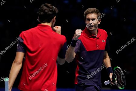 France's Nicolas Mahut (R) and Pierre-Hugues Herbert (L) react after winning their mens doubles semi final match against Lukasz Kubot of Poland and Marcelo Melo of Brazil at the ATP World Tour Finals tennis tournament in London, Britain, 16 November 2019.