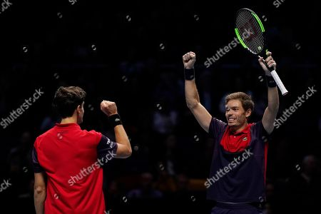 Stock Image of France's Nicolas Mahut (R) and Pierre-Hugues Herbert (L) react after winning their mens doubles semi final match against Lukasz Kubot of Poland and Marcelo Melo of Brazil at the ATP World Tour Finals tennis tournament in London, Britain, 16 November 2019.