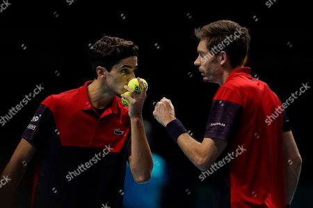 France's Nicolas Mahut (R) and Pierre-Hugues Herbert (L) during their mens doubles semi final match against Lukasz Kubot of Poland and Marcelo Melo of Brazil at the ATP World Tour Finals tennis tournament in London, Britain, 16 November 2019.