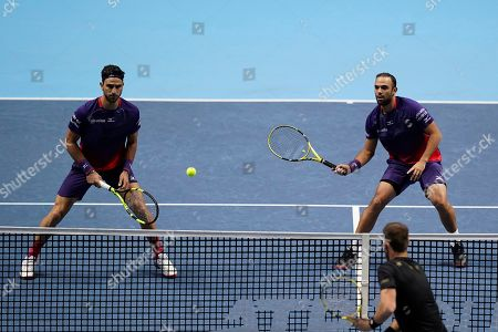 Colombia's Robert Farah and Juan Sebastian Cabal in action during their mens doubles semi final match against Raven Klaasen of South Africa and Michael Venus of New Zealand  at the ATP World Tour Finals tennis tournament in London, Britain, 16 November 2019.