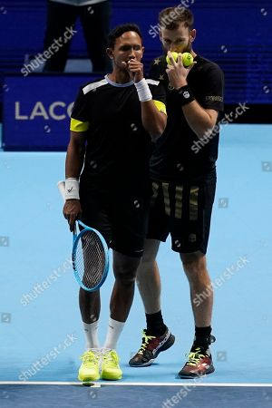 Raven Klaasen of South Africa (L) and Michael Venus of New Zealand (R) react during their mens doubles semi final match against Colombia's Robert Farah and Juan Sebastian Cabal at the ATP World Tour Finals tennis tournament in London, Britain, 16 November 2019.