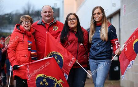 Stock Image of Ospreys vs Munster. Munster fans Mary, John and Sinead O'Regan with Lauren Kelly