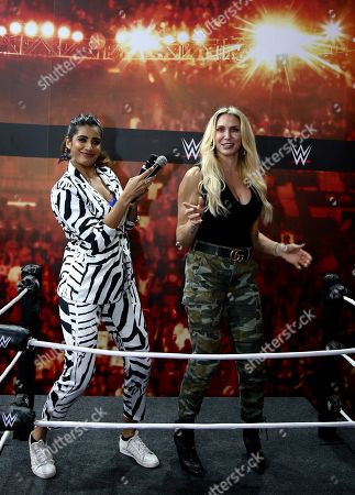 World Wrestling Entertainment (WWE) Women's Champion Charlotte Flair (R), whose birth name is Ashley Elizabeth Fliehr, from the US, dances to Bollywood tunes during her visit to the 'Comic Con 2019' in Bangalore, India, 16 November 2019. Described as India's greatest pop-culture event the two-day Comic Con is showcasing different comic character brands as well as 'the coolest collectibles, comics and accessories and the best of comics, books, film & TV, merchandize and gaming' until 18 November 2019.
