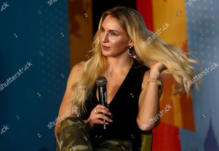 World Wrestling Entertainment (WWE) Women's Champion Charlotte Flair, whose birth name is Ashley Elizabeth Fliehr, from the US, speaks to visitors during her visit to the 'Comic Con 2019' in Bangalore, India, 16 November 2019. Described as India's greatest pop-culture event the two-day Comic Con is showcasing different comic character brands as well as 'the coolest collectibles, comics and accessories and the best of comics, books, film & TV, merchandize and gaming' until 18 November 2019.