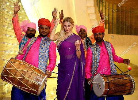 Stock Picture of World Wrestling Entertainment (WWE) Women's Champion Charlotte Flair (C), whose birth name is Ashley Elizabeth Fliehr, from the US, poses in a Indian traditional saree during her visit to the 'Comic Con 2019' in Bangalore, India, 16 November 2019. Described as India's greatest pop-culture event the two-day Comic Con is showcasing different comic character brands as well as 'the coolest collectibles, comics and accessories and the best of comics, books, film & TV, merchandize and gaming' until 18 November 2019.