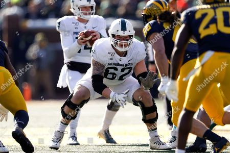 Michigan State offensive lineman Luke Campbell (62) plays against Michigan in the first half of an NCAA college football game in Ann Arbor, Mich
