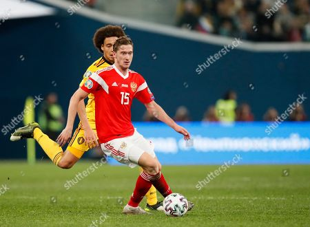 Russia's Aleksei Miranchuk, center, and Belgium's Axel Witsel run for the ball during the Euro 2020 group I qualifying soccer match between Russia and Belgium, at Gazprom Arena in St. Petersburg, Russia