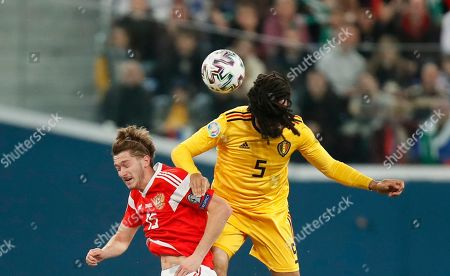 Belgium's Jason Denayer, right, jumps for the ball with Russia's Aleksei Miranchuk during the Euro 2020 group I qualifying soccer match between Russia and Belgium, at Gazprom Arena in St. Petersburg, Russia