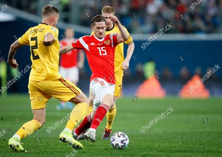 Russia's Aleksei Miranchuk, center, duels for the ball with Belgium's Toby Alderweireld during the Euro 2020 group I qualifying soccer match between Russia and Belgium, at Gazprom Arena in St. Petersburg, Russia
