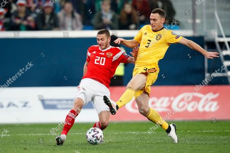 Russia's Aleksei Ionov, left, duels for the ball with Belgium's Thomas Vermaelen during the Euro 2020 group I qualifying soccer match between Russia and Belgium, at Gazprom Arena in St. Petersburg, Russia