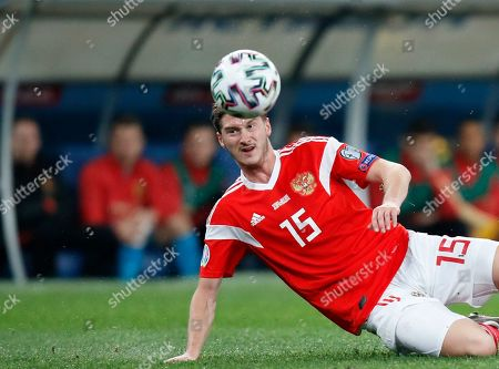 Russia's Aleksei Miranchuk kicks the ball during the Euro 2020 group I qualifying soccer match between Russia and Belgium, at Gazprom Arena in St. Petersburg, Russia