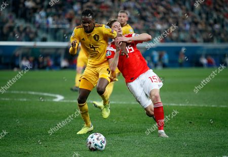Belgium's Dedryck Boyata, left, duels for the ball with Russia's Aleksei Miranchuk during the Euro 2020 group I qualifying soccer match between Russia and Belgium, at Gazprom Arena in St. Petersburg, Russia