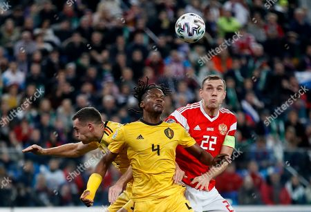 Russia's Artem Dzyuba, right, jumps for the ball with Belgium's Dedryck Boyata, center, and Thomas Vermaelen during the Euro 2020 group I qualifying soccer match between Russia and Belgium, at Gazprom Arena in St. Petersburg, Russia