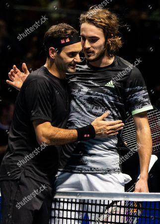 Roger Federer of Switzerland and Stefanos Tsitsipas of Greece