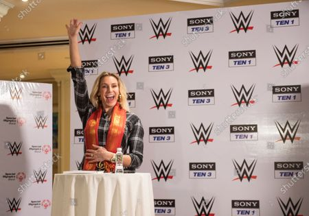 10-time WWE Women's Champion Charlotte Flair gestures as she celebrates Children's Day with the kids