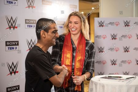10-time WWE Women's Champion Charlotte Flair shakes hands with a boy from Special Olympics Bharat at ITC Maratha