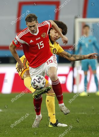Axel Witsel (back) of Belgium in action against Aleksei Miranchuk (front) of Russia during the UEFA Euro 2020 Group I qualifying soccer match between Russia and Belgium at the Gazprom Arena in St. Petersburg, Russia, 16 November 2019.