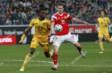 Michy Batshuayi (L) of Belgium in action against Aleksei Miranchuk (C) of Russia during the UEFA Euro 2020 Group I qualifying soccer match between Russia and Belgium at the Gazprom Arena in St. Petersburg, Russia, 16 November 2019.