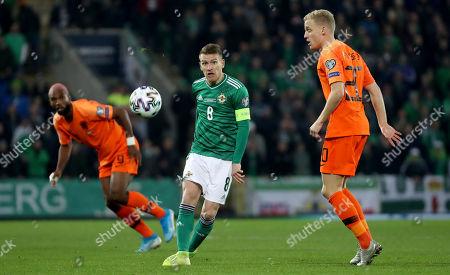 Northern Ireland vs The Netherlands. Northern Ireland's Steven Davis with Netherlands' Donny van de Beek